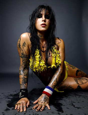 She is the Tattoo Artist her on that reality TV show Miami Ink & LA ink.