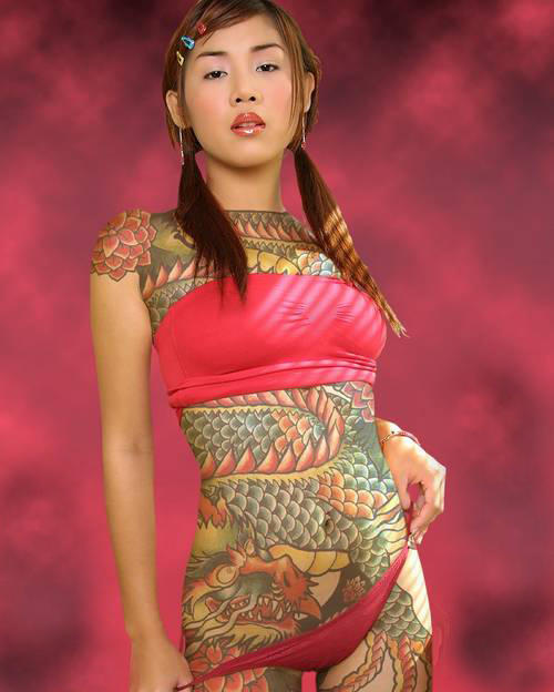 This is a photo of a full body tattoo of a large Japanese dragon.
