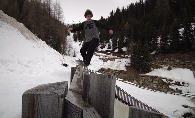 Niels Schack and Johnnie Paxson snowboarding on a fence