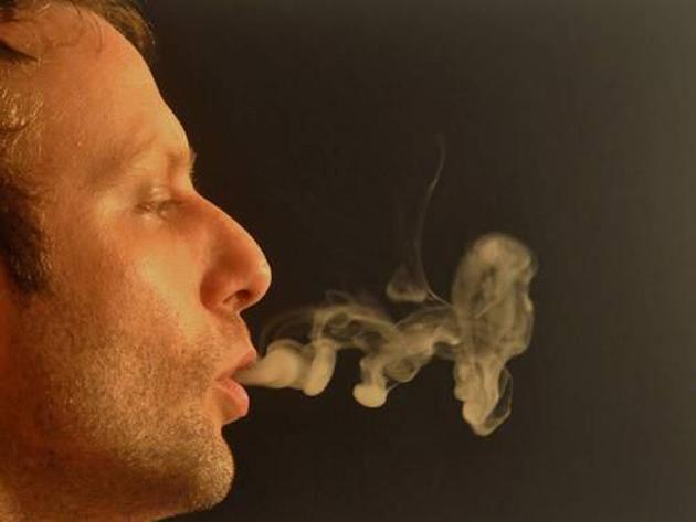 artist paints with marijuana smoke