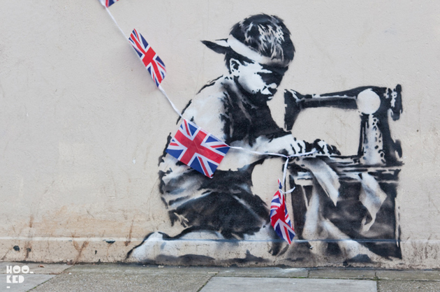 banksy stencil child sewing flags