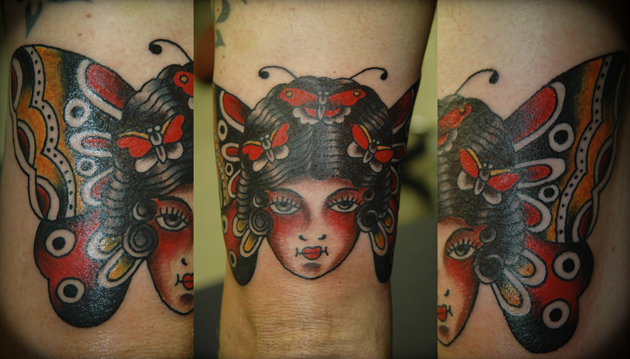 butterfly head tattoo