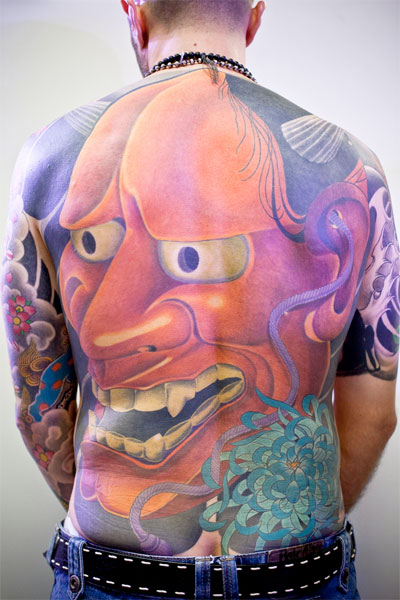 This large back tattoo is a Japanese Hannya mask.