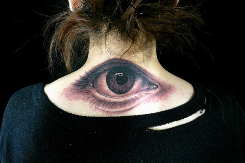 The black and white tattoo of a human eye is very well detailed and a unique