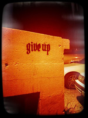 give up stencil graffiti