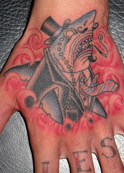 hand shark in suit and tie with a monocle tattoo