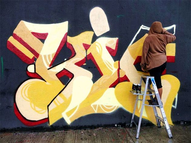 kif painting a wall