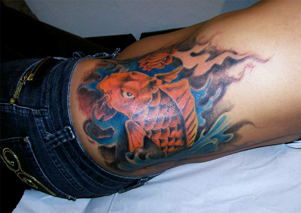 Tuesday we've featured a nice tattoo of a koi fish on a girl's rib cage.