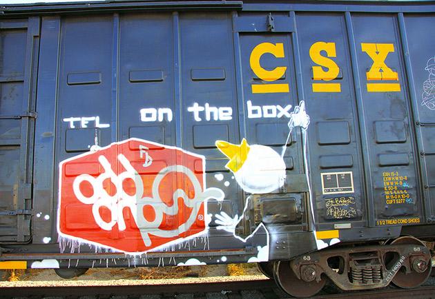 odd one graffiti on boxcar