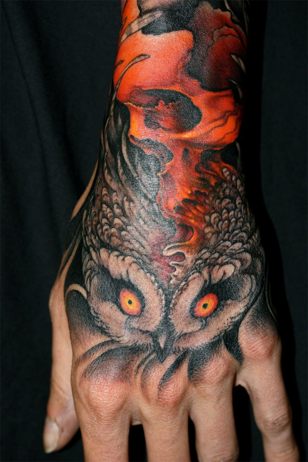 ... hand tattoo of a skull and owl done by the artist Jeff Gogue
