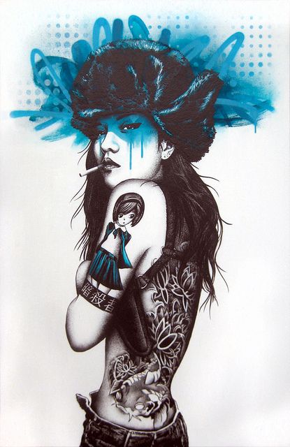 tattooed female painting by fin dac