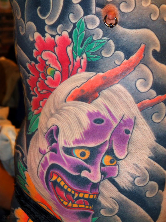 Here's an amazing rib cage tattoo of a Japanese demon.
