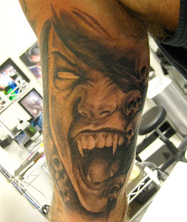 vampire tattoo arm