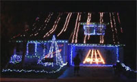 Guitar Hero Played on a House with Christmas Lights