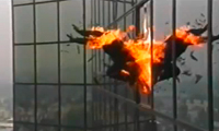 Man on Fire Leaps Out of a Skyscraper