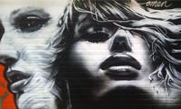 New Omen Graffiti on a Garage